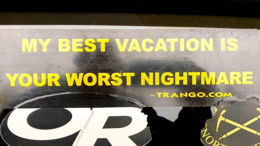 A bumper sticker from my climbing days when I would seek intense adventure to distract myself from my dissatisfying working life. No more nightmare vacations for me. (Photograph by Tom Morin)