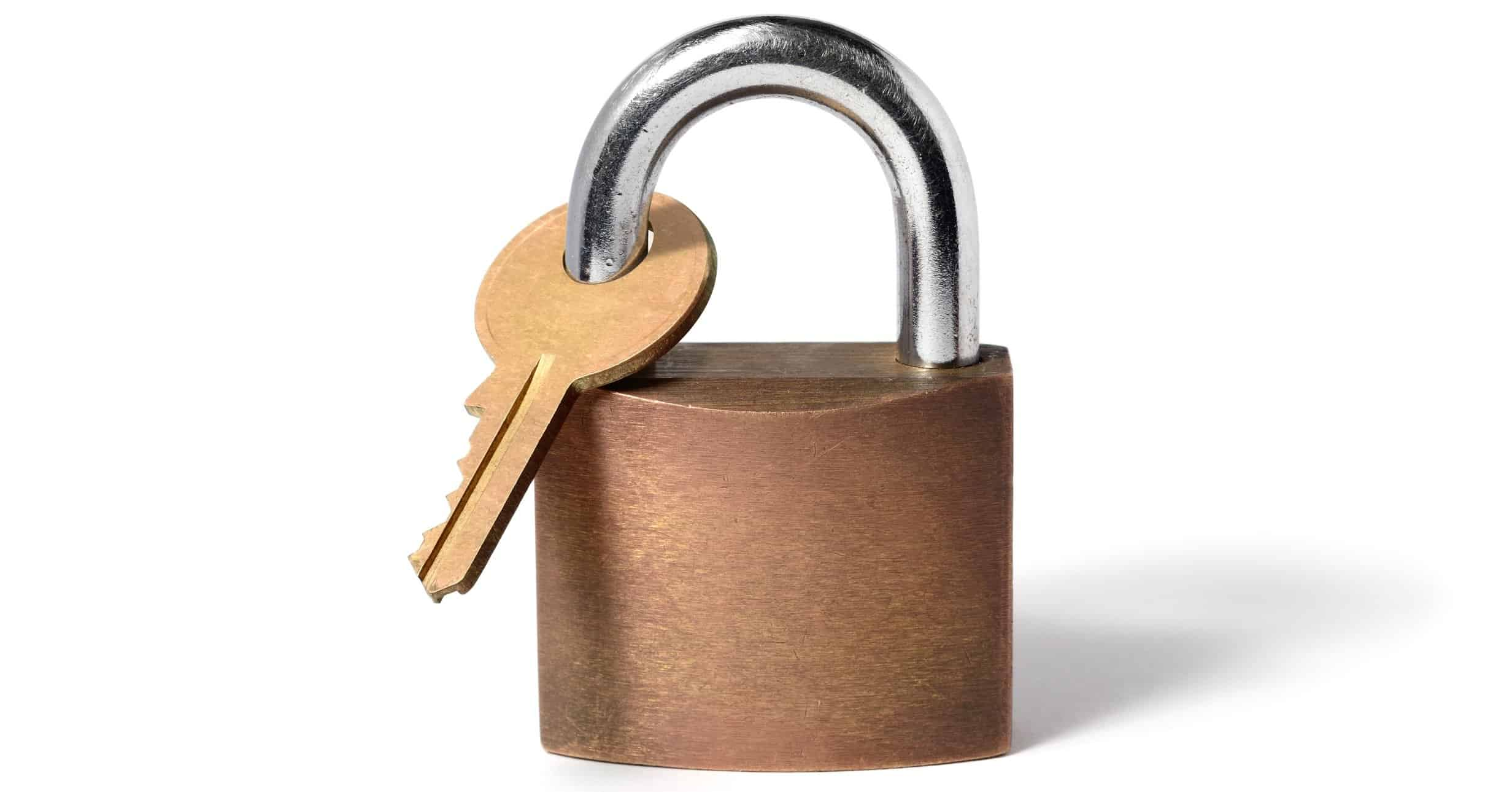 Picture of padlock with its key locked with the padlock. This is an image of self-sabotage.